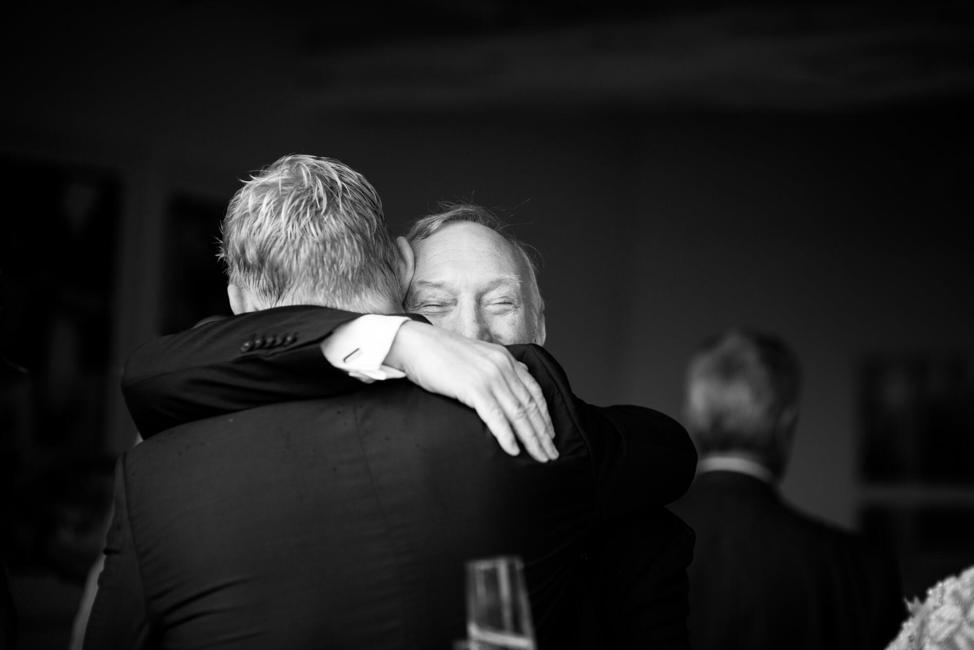 father of groom groom hug happy moment