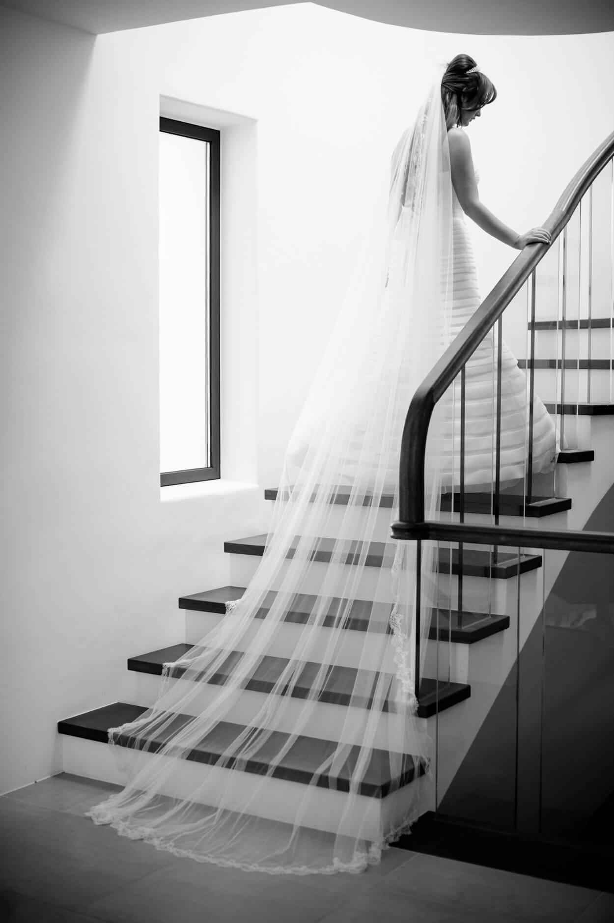 bride portrait long veil staircase black white photo