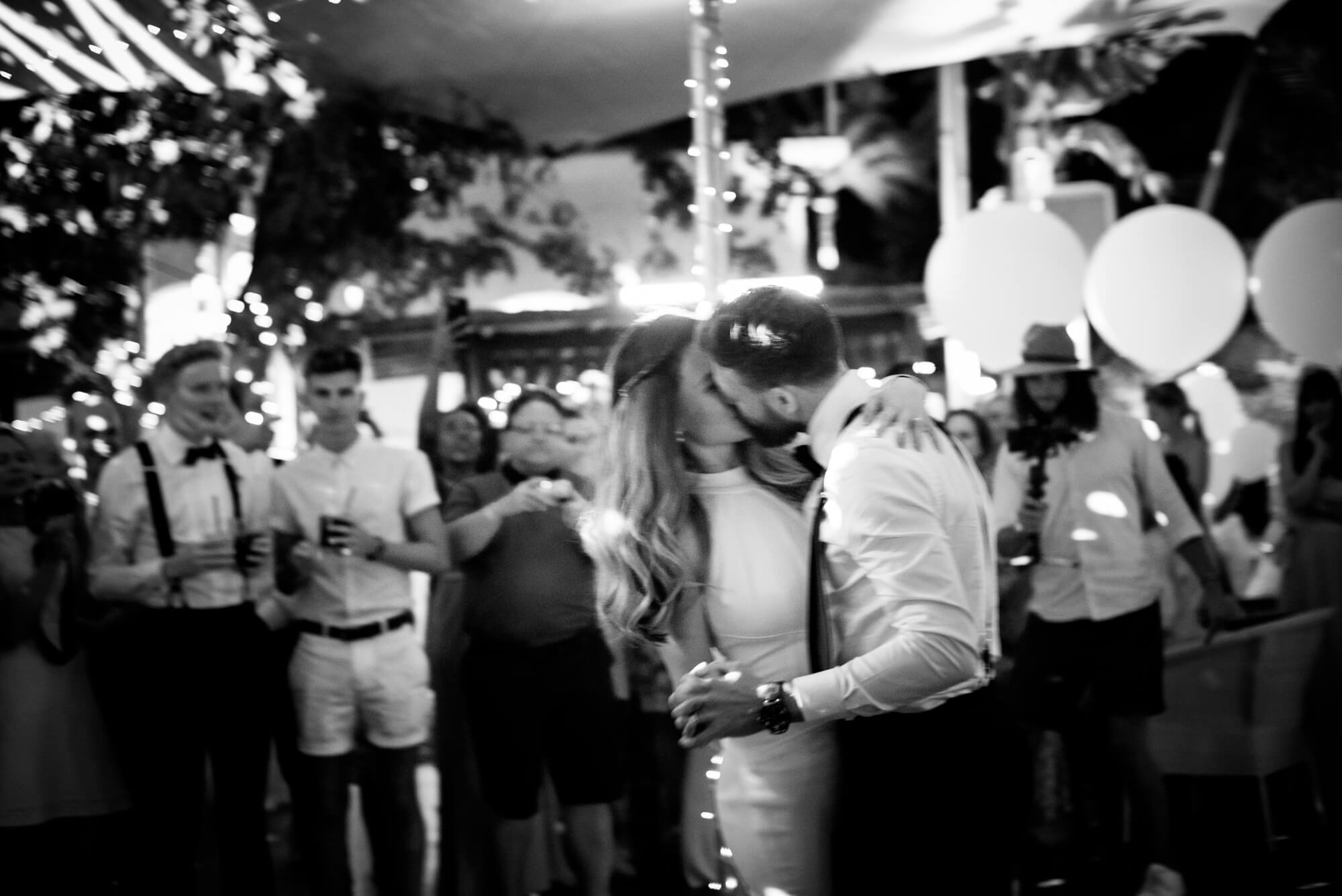 first dance bride groom kiss blur out of focus