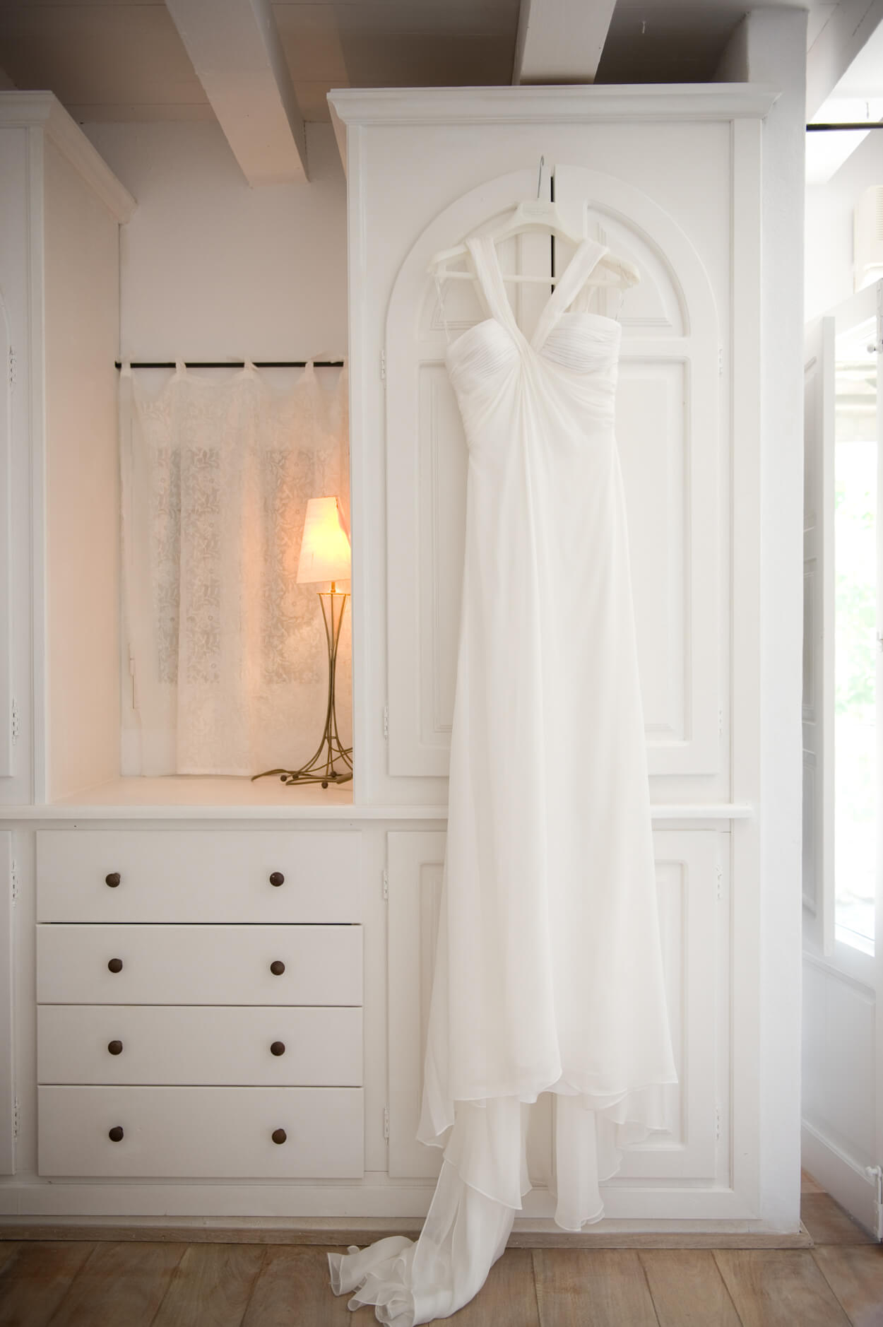 wedding dress cross neck hanging bride getting ready