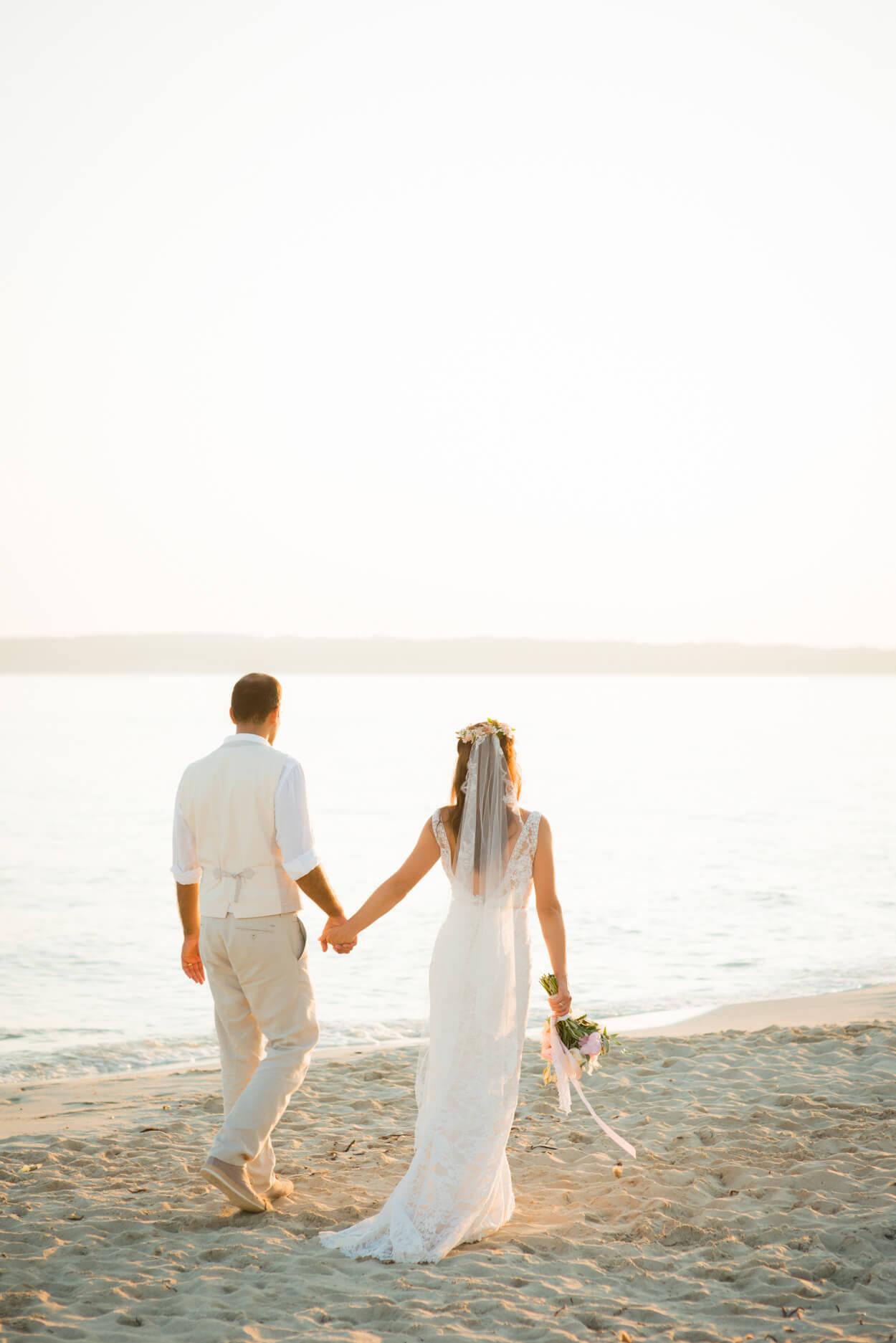 beach walk sunset bride groom lace veil