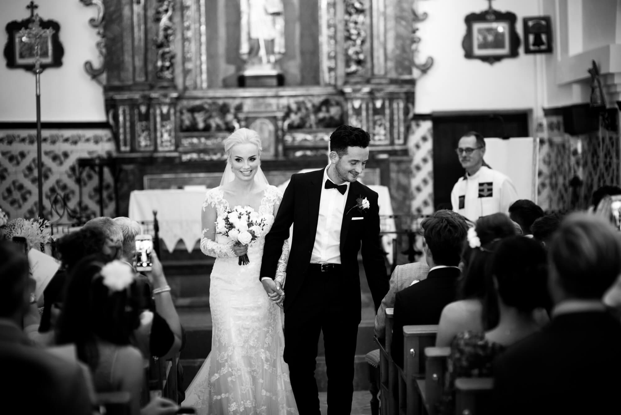 bride groom ceremony exit church wedding black tie lace dress