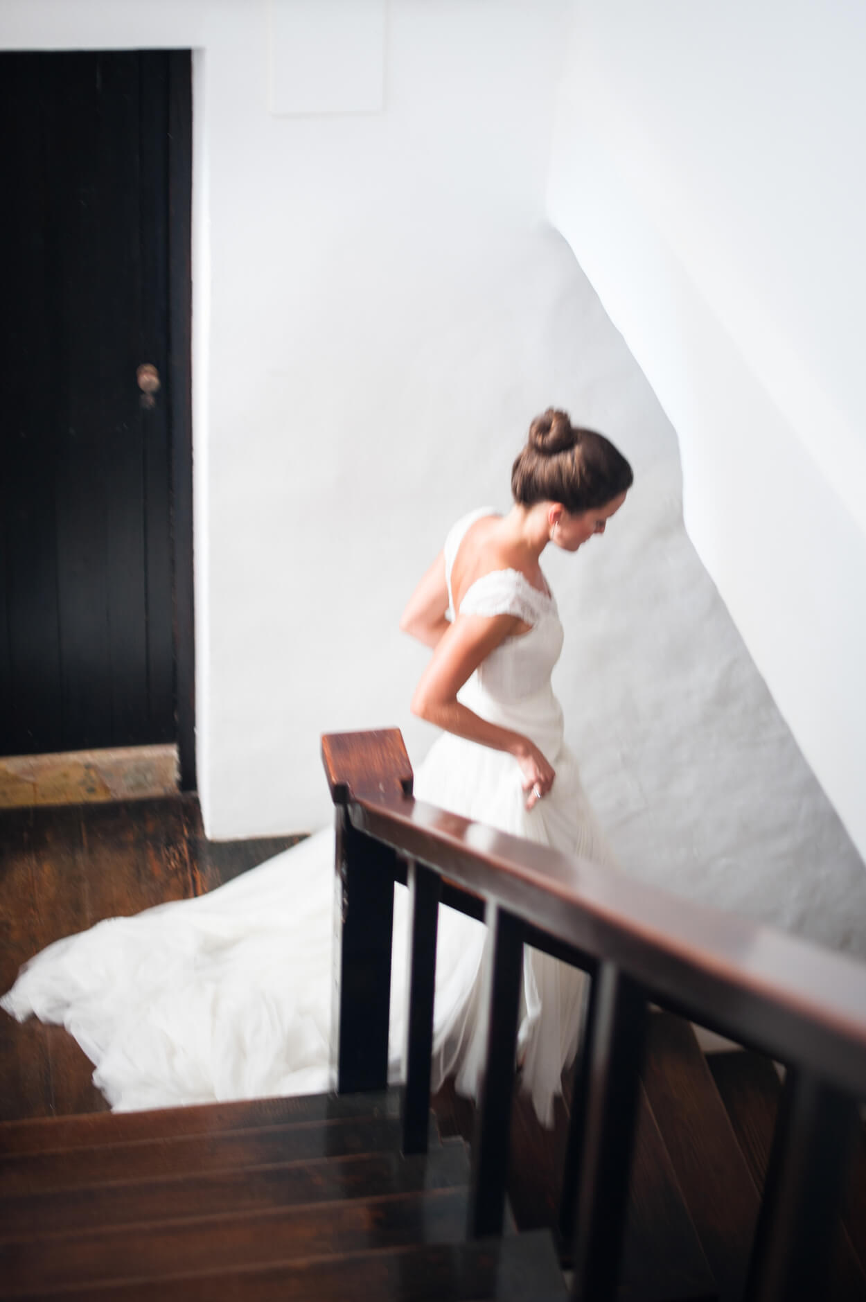 bride walking stairs ceremony entrance blur photo