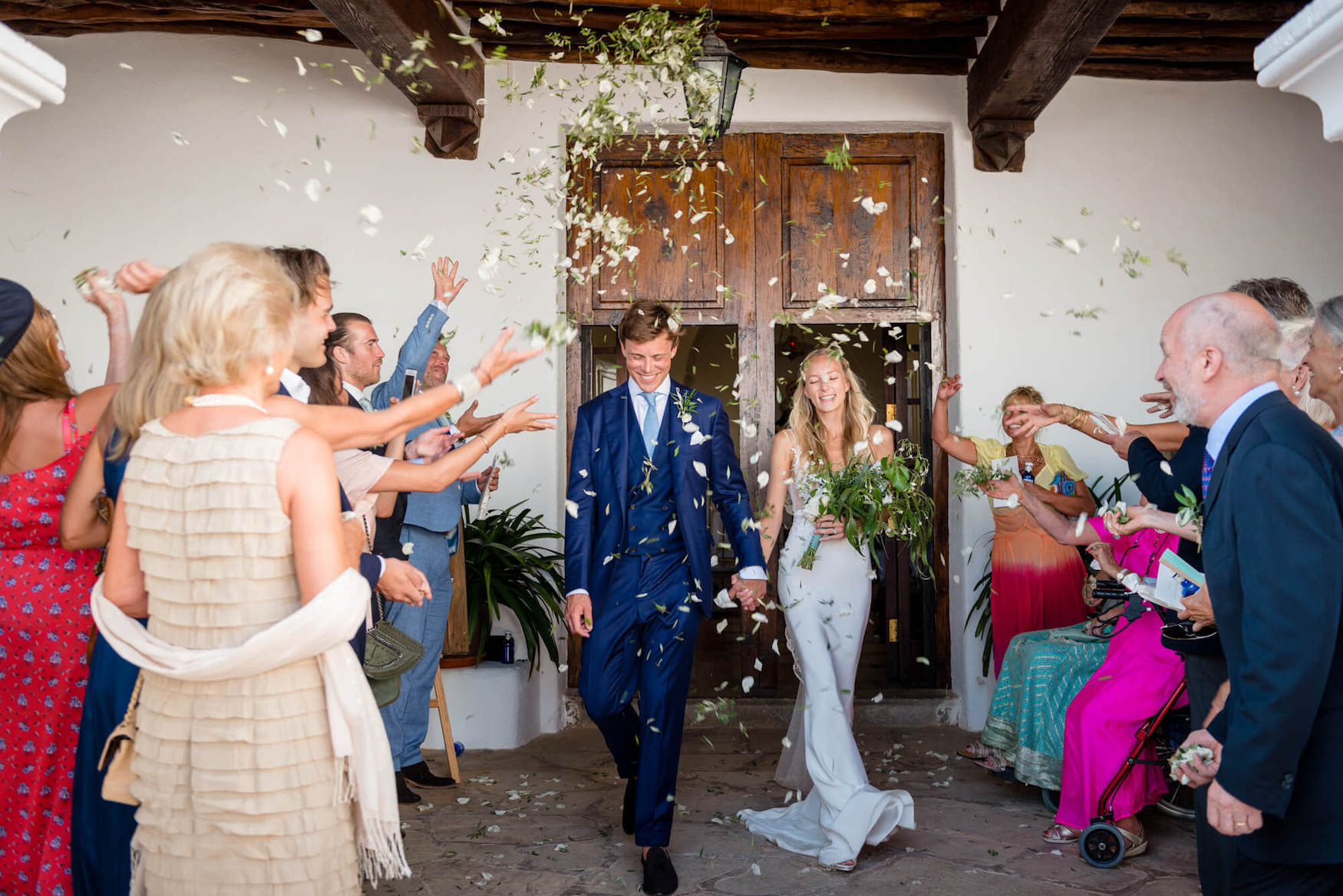 bride groom cofetti moment  olive leave petal confetti happy couple