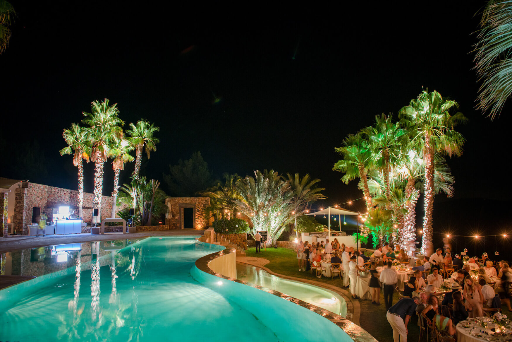 dinner under stars pool side wedding evening meal festoon lighting