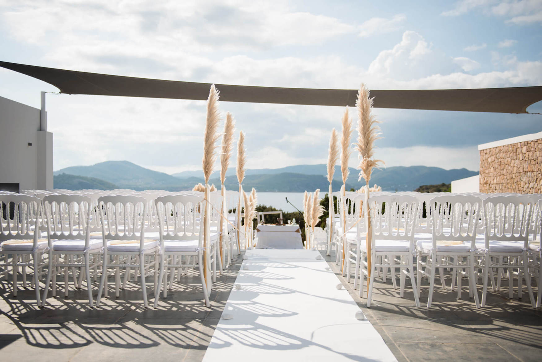 ceremony by the sea hills background pampas grass shadows