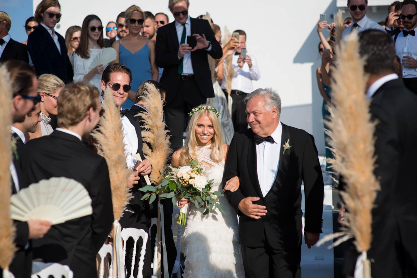 bride father of bride ceremomy arrival pampas grass black tie pronovias dress