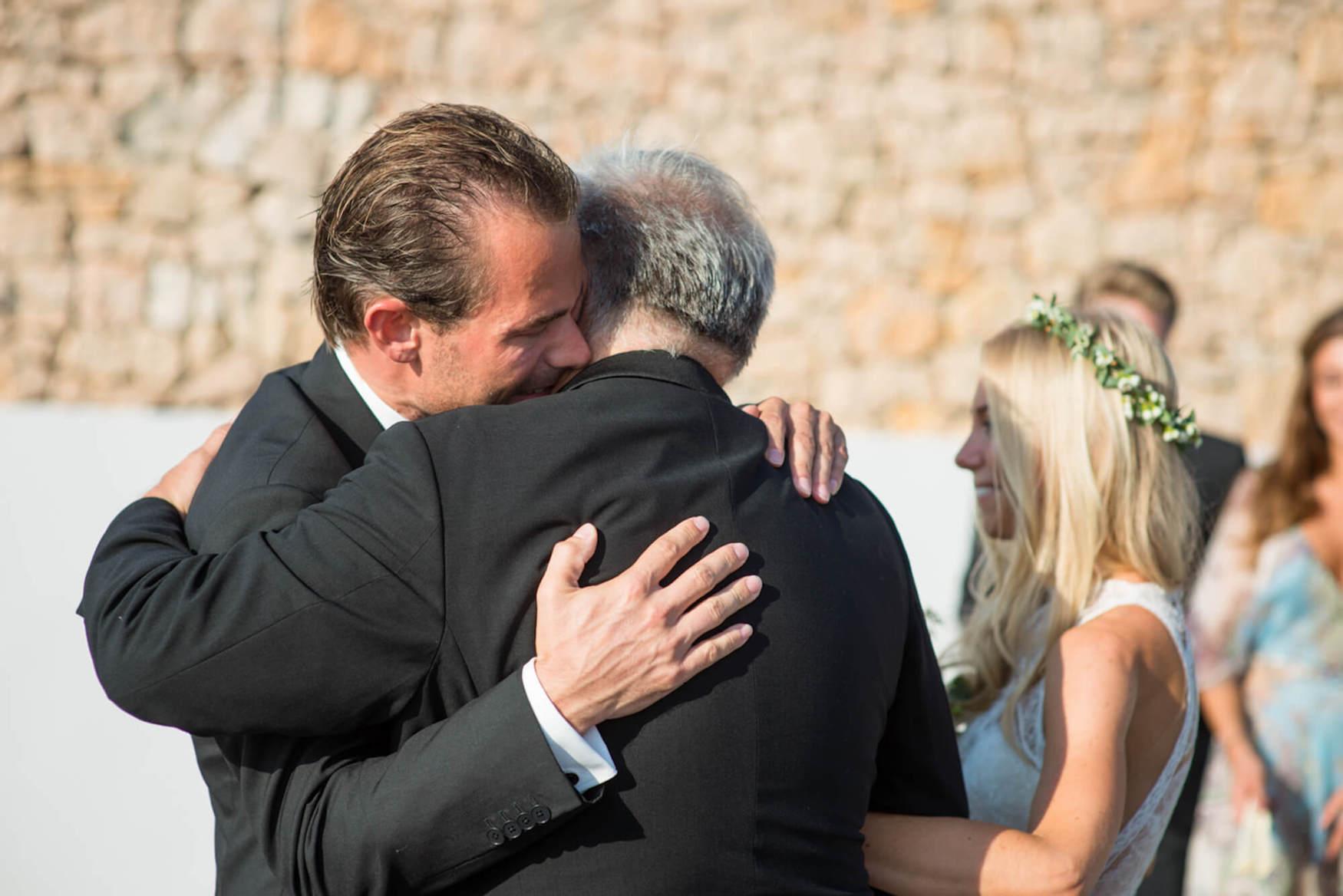 bride groom sunset ceremony father of bride tears black tie flower crown pronovias dress