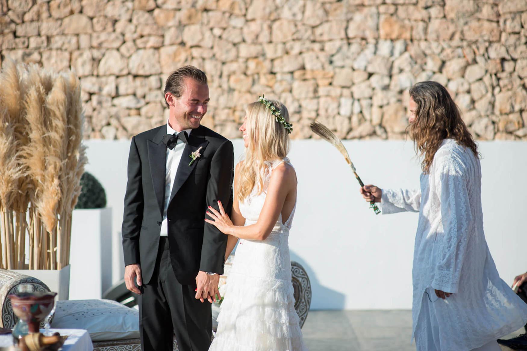 bride groom sunset ceremony aura cleanse laughter happy tears black tie flower crown pronovias dress