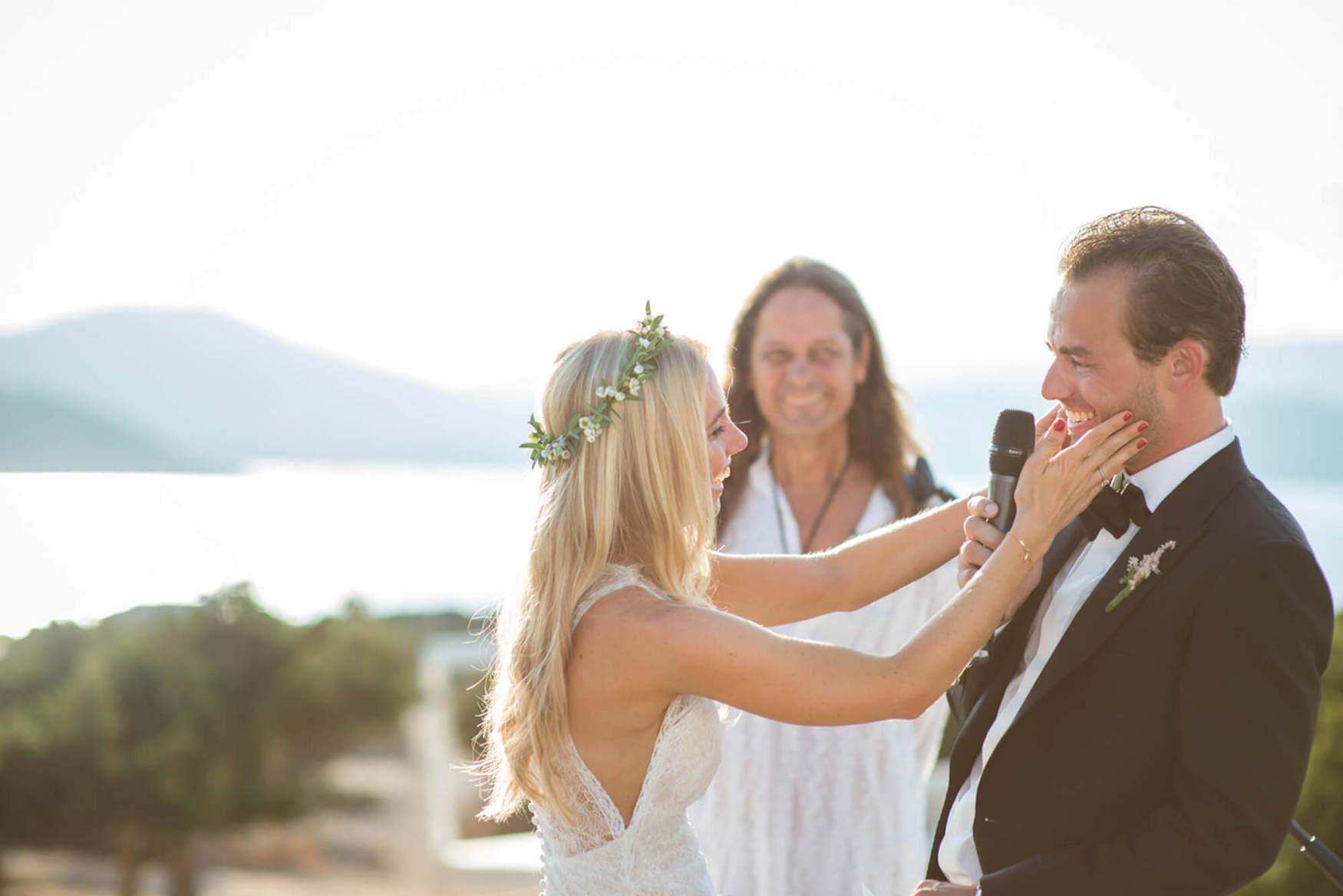 bride groom sunset ceremony laughter black tie flower crown pronovias