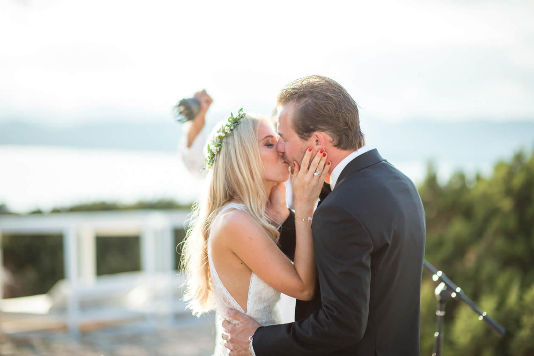 bride groom sunset kiss ceremony black tie flower crown pronovias dress