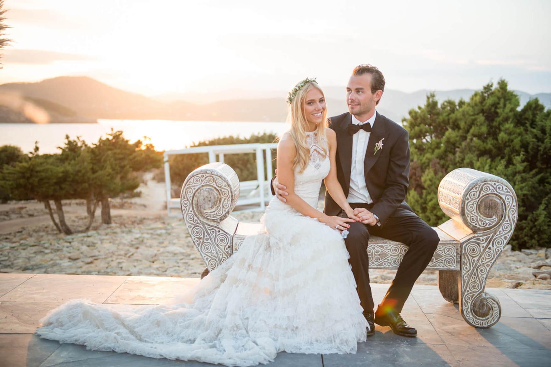 bride groom sunset kiss throne bench black tie flower crown pronovias