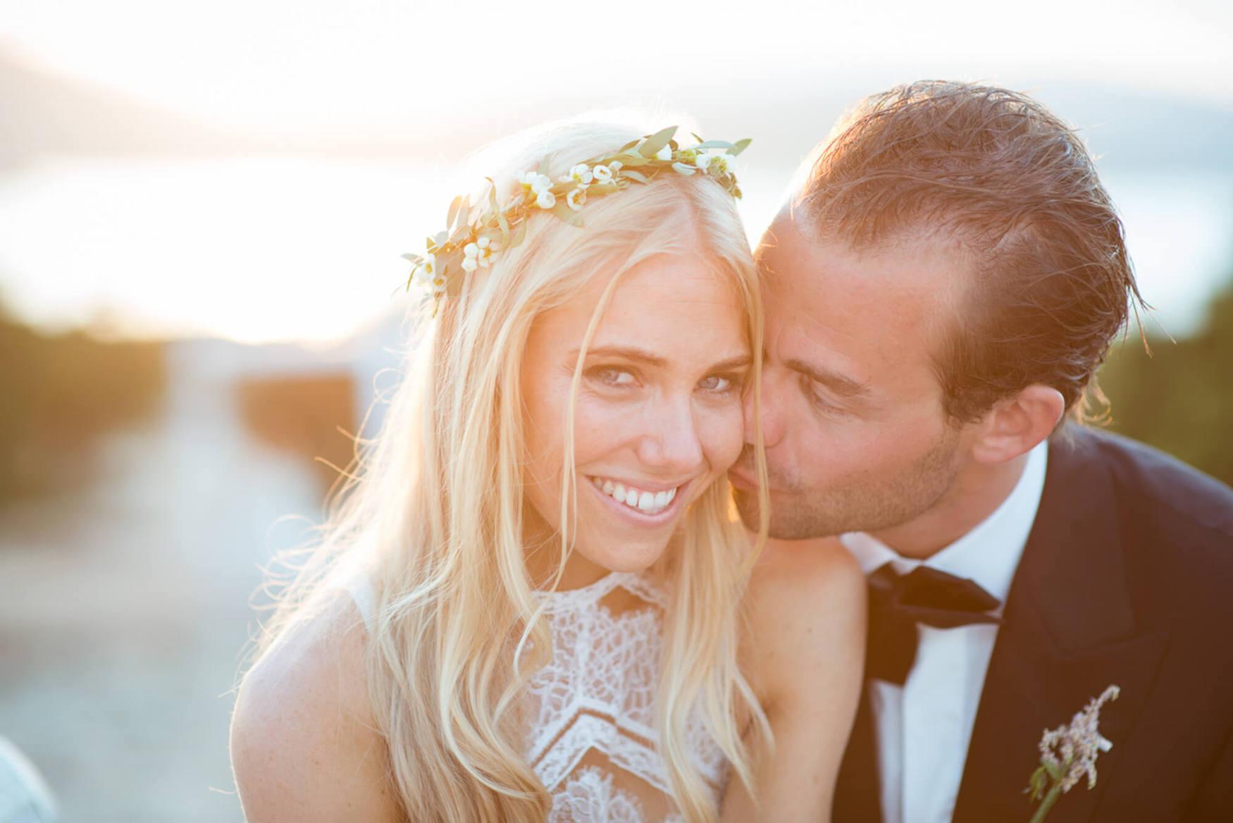 bride groom sunset kiss black tie flower crown pronovias