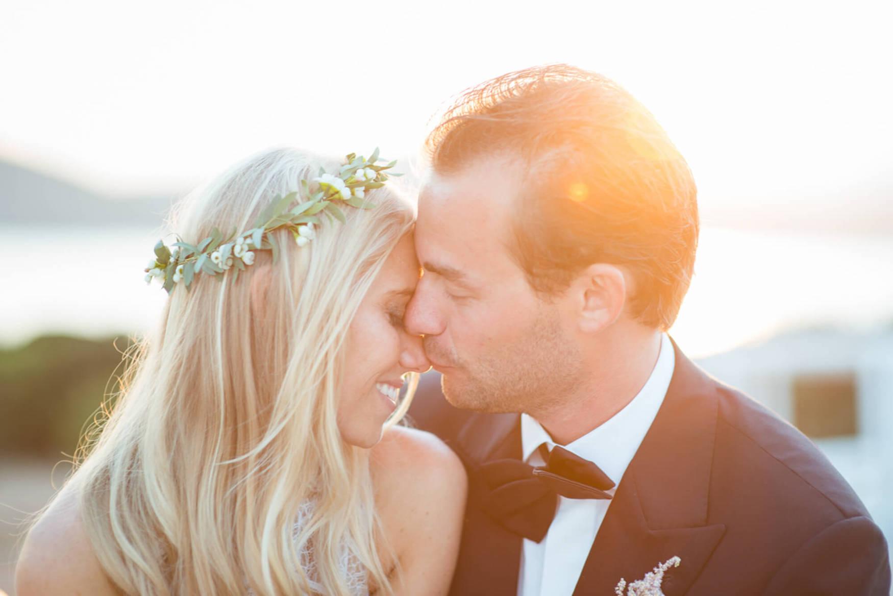 bride groom sunset kiss black tie flower crown