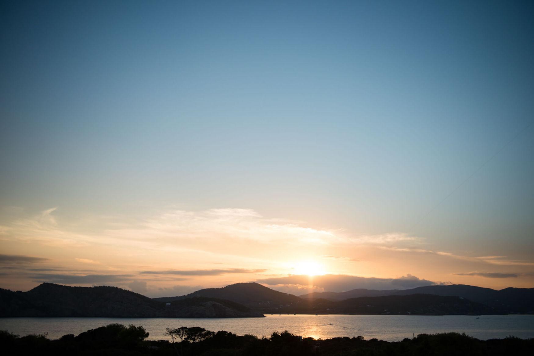 sunset over hills dusk light silhouette