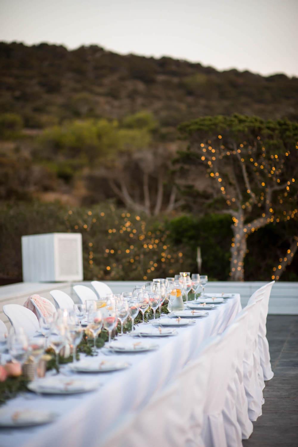 wedding dinner poolside night glow black tie fairy lights