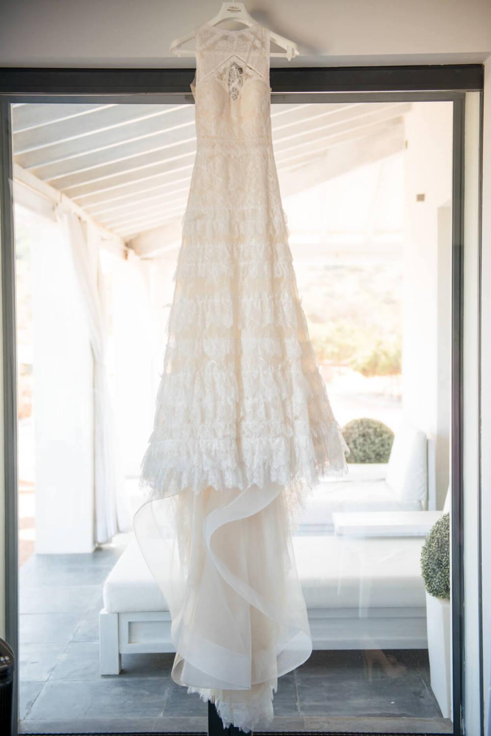 hanging pronovias lace wedding dress long train